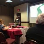 Renee Groskreutz keeps the crowd taking notes.
