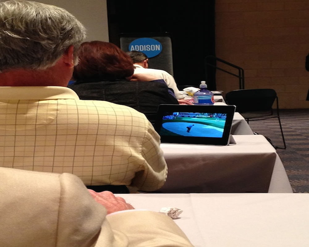 Someone watches golf during the keynote